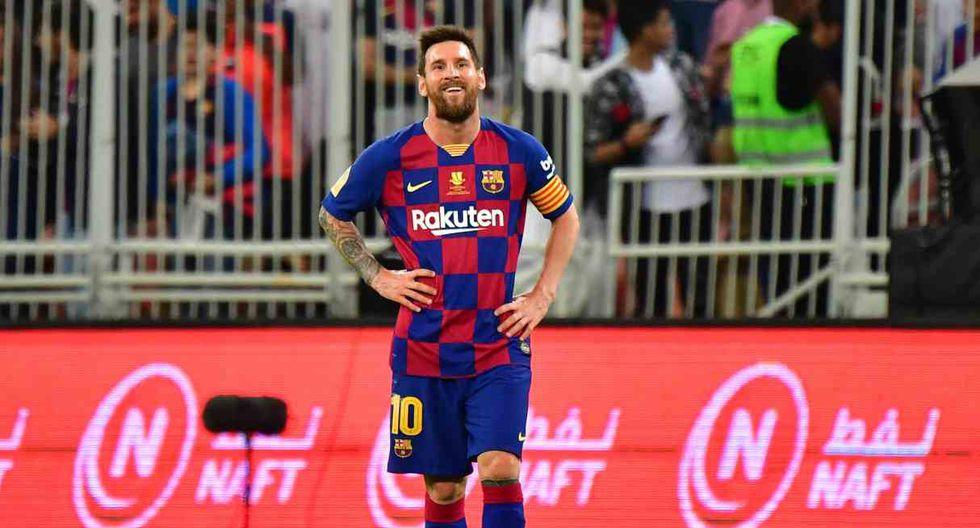 Lionel Messi y el tenso momento vivido con un fanático que saltó a la cancha. (Foto: AFP)