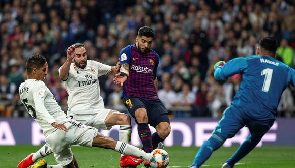 Raphael Varane es duda en el Real Madrid para el clásico ante Barcelona de este sábado por LaLiga. (Foto: EFE)