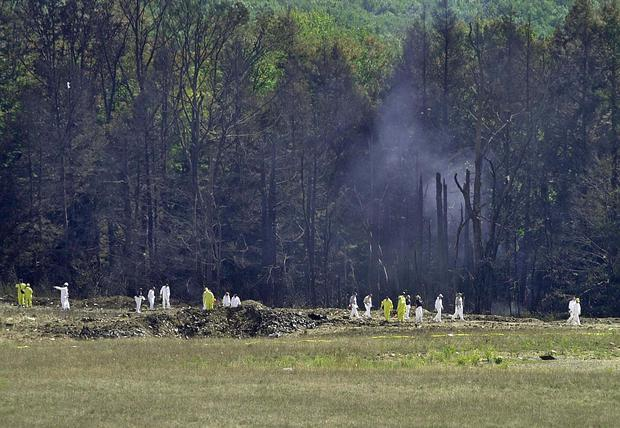 Investigators record the crash site of United Airlines Flight 93 in Shanksville, Pennsylvania.  (David MAXWELL / AFP).