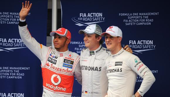 Una foto del 2012, cuando Lewis Hamilton estaba en McLaren y Schumacher en Mercedes. (Foto: AFP)