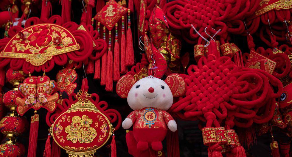 El año nuevo chino es un motivo de reunión familiar, muchas veces la única oportunidad que tienen para reencontrarse durante el año (Foto: AFP)