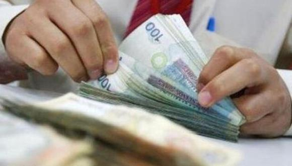 La Superintendencia de Bancas, Seguros y AFP (SBS) anunció que las solicitudes para retirar hasta 17.200 soles del fondo de pensiones (4 UIT) podrán presentarse desde el próximo 9 de diciembre (Foto: AFP)