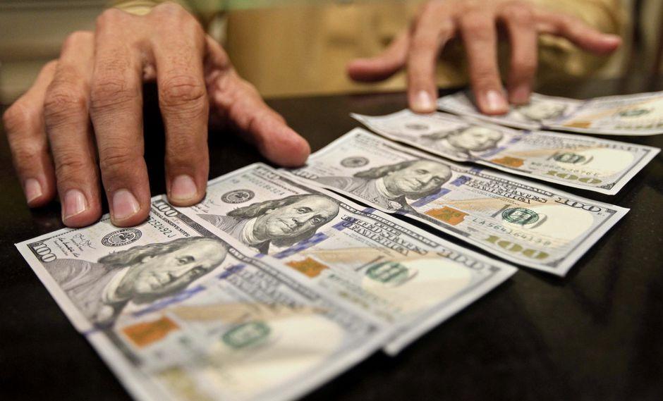 El dólar en el mercado paralelo se cotizó en la jornada previa a 13.680,81 bolívares soberanos. (Foto: EFE)