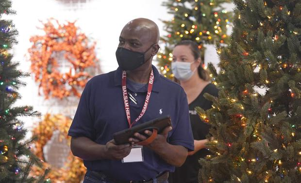 Balsam Hill Outlet Sales Associate Rickey Haynes listens to Manager Kelly Bratt during training in Allen, Texas.  (AP Photo / LM Otero).