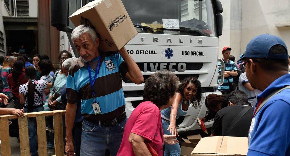 El programa Comités Locales de Abastecimiento y Producción (CLAP) fue lanzado por Nicolás Maduro en el 2016. (AFP).