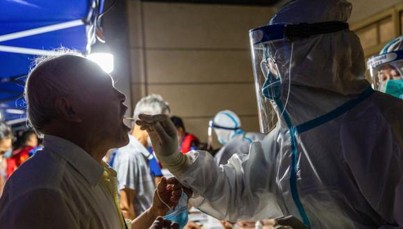 Coronavirus en China | Últimas noticias | Último minuto: reporte de infectados y muertos por COVID-19 hoy, jueves 22 de julio del 2021. (Foto: STR / AFP / China OUT).