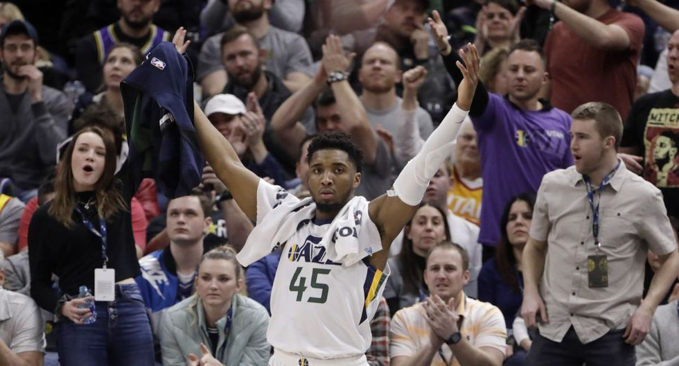 Utah Jazz guard Donovan Mitchell cheers on the team during the second half of an NBA basketball game against the Denver Nuggets on Wednesday, Feb. 5, 2020, in Salt Lake City. (AP Photo/Rick Bowmer)