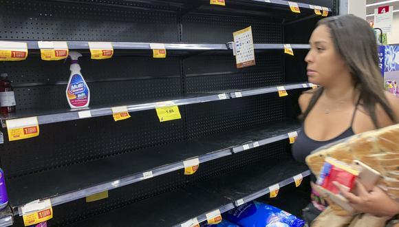 Los anaqueles de los supermercados han quedado vacíos en muchos países del mundo ante la llegada del Covid-19. (Foto: Luis ACOSTA / AFP)