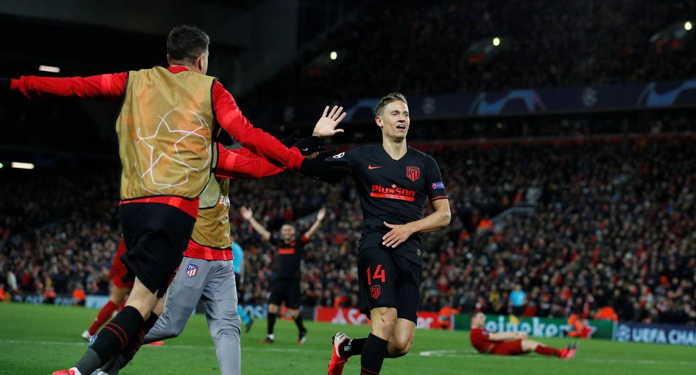 Soccer Football - Champions League - Round of 16 Second Leg - Liverpool v Atletico Madrid - Anfield, Liverpool, Britain - March 11, 2020  Atletico Madrid's Marcos Llorente celebrates scoring their second goal with teammates   REUTERS/Phil Noble