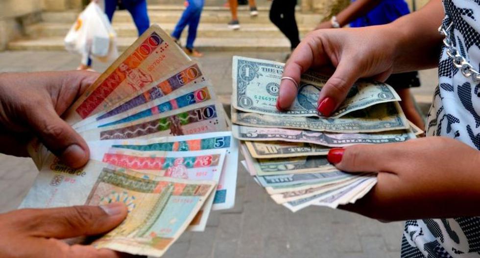 Cuba suspends cash dollar deposits on the island