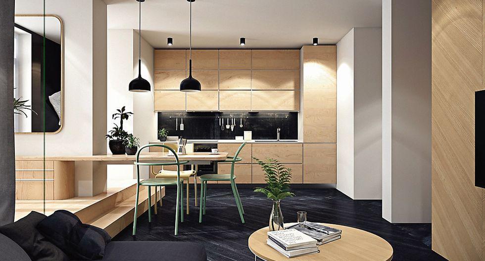 Se eligió una pieza gris oscura para conjugar con los tonos neutros del sofá y realzar el contraste con la mesa de madera clara. La pared principal está vestida con cuadros de marcos sencillos que no recargan el lugar. (Studio Pine)