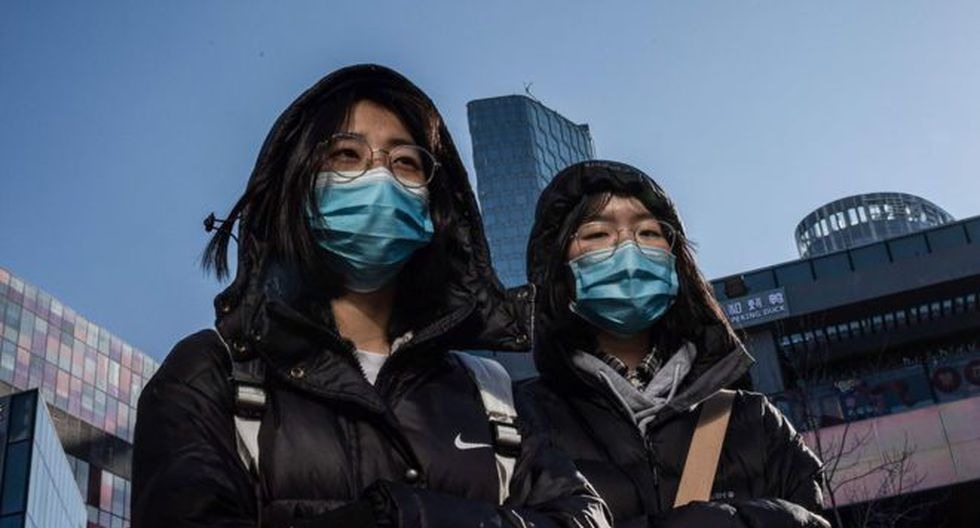 Es muy frecuente ver a personas con mascarillas en las calles de distintas ciudades chinas. (Foto: AFP)