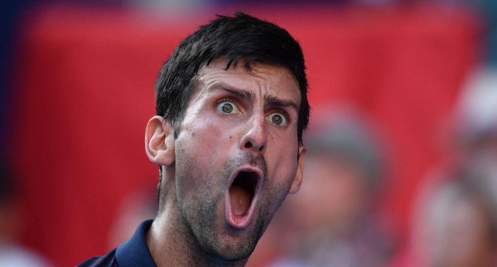 Novak Djokovic reacciona después de un punto contra el belga David Goffin en su partido de semifinales de individuales masculinos en el torneo de tenis Open de Japón en Tokio. (Kazuhiro Nogi / AFP)