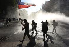 Decenas de manifestantes en Chile desafían silencio electoral del plebiscito | FOTOS