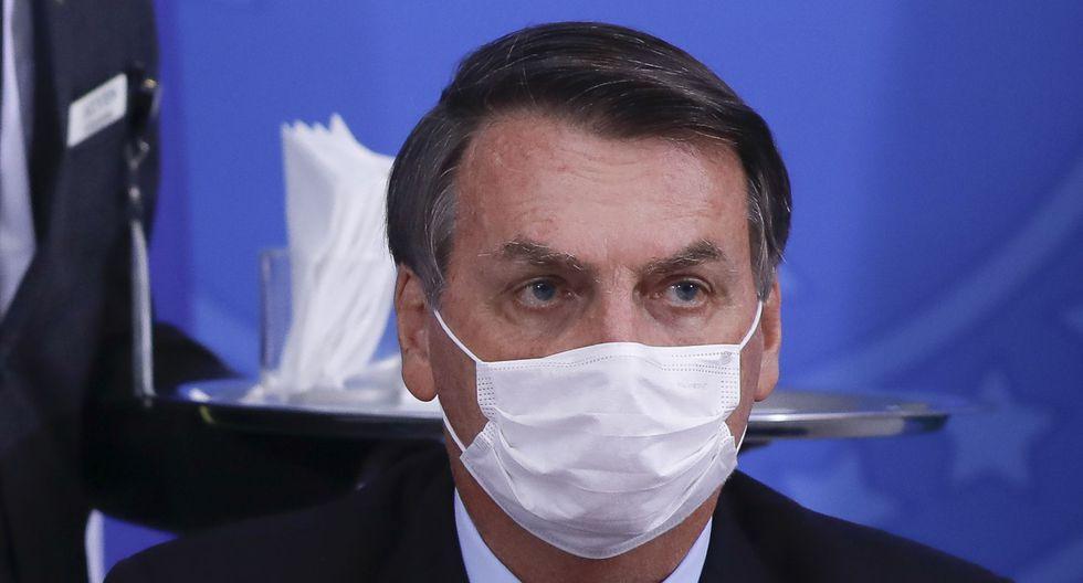 Tras confirmar que la prueba de coronavirus a la que fue sometido salió positiva, el presidente de Brasil anunció que se está tratando con dos fármacos cuya efectividad divide a la comunidad científica por la falta de pruebas sobre sus resultados. (Foto: Sergio Lima / AFP)