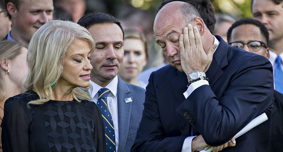 Kellyanne Conway, senior advisor to U.S. President Donald Trump, left, speaks with Gary Cohn, director of the U.S. National Economic Council, before a moment of silence with U.S. President Donald Trump, not pictured, in remembrance of those lost during the September 11, 2001 terrorist attacks, on the South Lawn of the White House in Washington, D.C., U.S., on Monday, Sept. 11, 2017. Trump is presiding over his first 9/11 commemoration on the 16th anniversary of the terrorist attacks that killed nearly 3,000 people when hijackers flew commercial airplanes into New York's World Trade Center, the Pentagon and a field near Shanksville, Pennsylvania. Photographer: Andrew Harrer/Bloomberg