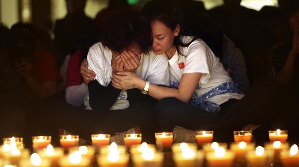 La angustia de las familias del MH370 a un mes de desaparecido  - 1