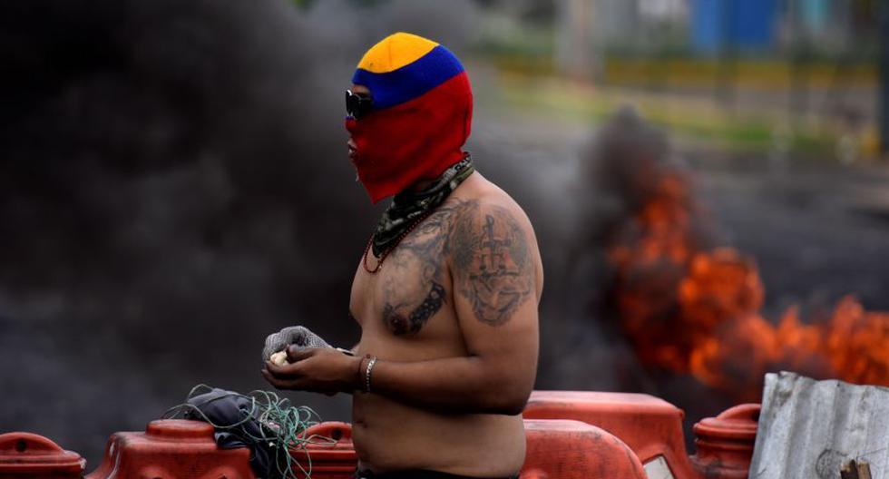 Un manifestante durante las protestas hoy en Cali (Colombia). (Foto: EFE/ Ernesto Guzmán Jr)
